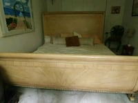 brown wooden bed frame with white mattress Rockville, 20851