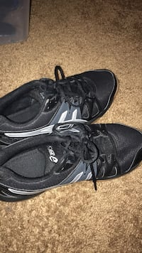 Pair of black low-top asics volleyball shoes Denton, 76209