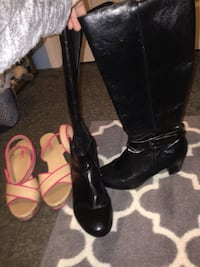 pair of black leather stacked heel wide-calf boots