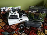 black Xbox 360 console with controllers and game cases North Bergen, 07047