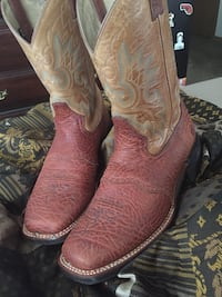 pair of brown leather cowboy boots 869 mi