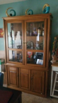 brown wooden framed glass display cabinet Fort Worth, 76134