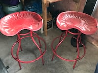 two red metal high chairs Rocky View No. 44, T1X 0H5