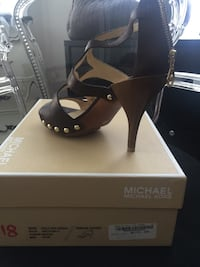 Pair of black leather peep-toe pumps with box