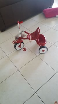toddler's red Radio Flyer pedaled trike