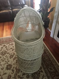 Vintage white wicker baby bassinet.  Includes white eyelet hood cover and bottom curtain. Manassas, 20110