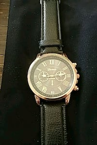 round silver-colored chronograph watch with brown leather strap Denver, 80204