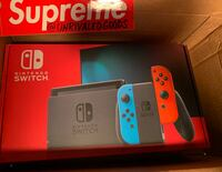 Nintendo Switch with Neon Blue and Neon Red Joy Con IN HAND