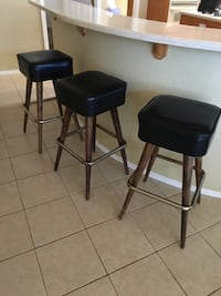 two black leather padded bar stools Las Vegas, 89130