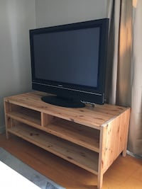 brown wooden TV stand with flat screen television CORNERBROOK