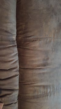 leather couch recines on each end no issues has alot of   peeling Wilmer, 36587
