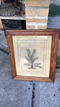 brown wooden framed painting of palm tree Robbins, 60472