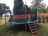 Black and blue trampoline with enclosure Windsor, N8R 2L4