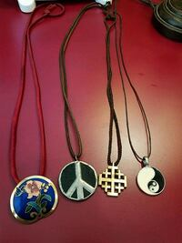three silver-colored pendant necklaces Greeneville, 37745