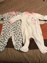 baby's two white and pink and black and white floral footie pajamas Gainesville, 30501