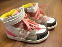 pair of gray-and-pink Adidas sneakers 539 km