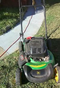 green and black push mower 550 mi