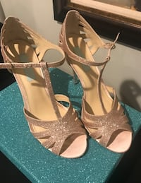 Pair of brown open-toe ankle strap heels