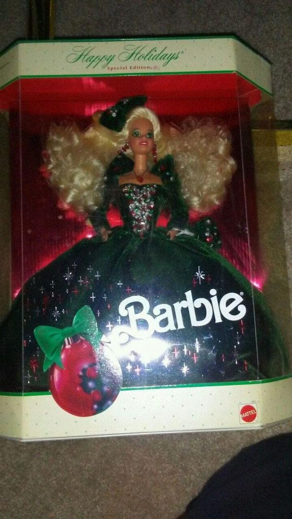 Barbie doll in black and pink dress