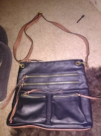 black and brown leather sling bag