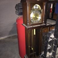 Brown wooden grand fathers clock Rosedale, 21237