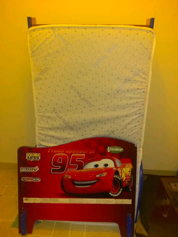 toddler cars bed with a brand new mattress