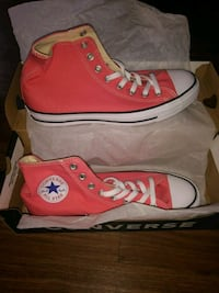 pair of red Converse All-Star high-tops 48 km
