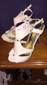 pair of white peep-toe sandals Prince George, V2L 2H6