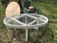round white metal framed glass top patio table Falconer, 14733
