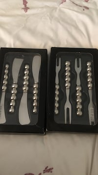 two set of grey stainless steel butter spreader and fish fork packs West Vancouver, V7V 1B3