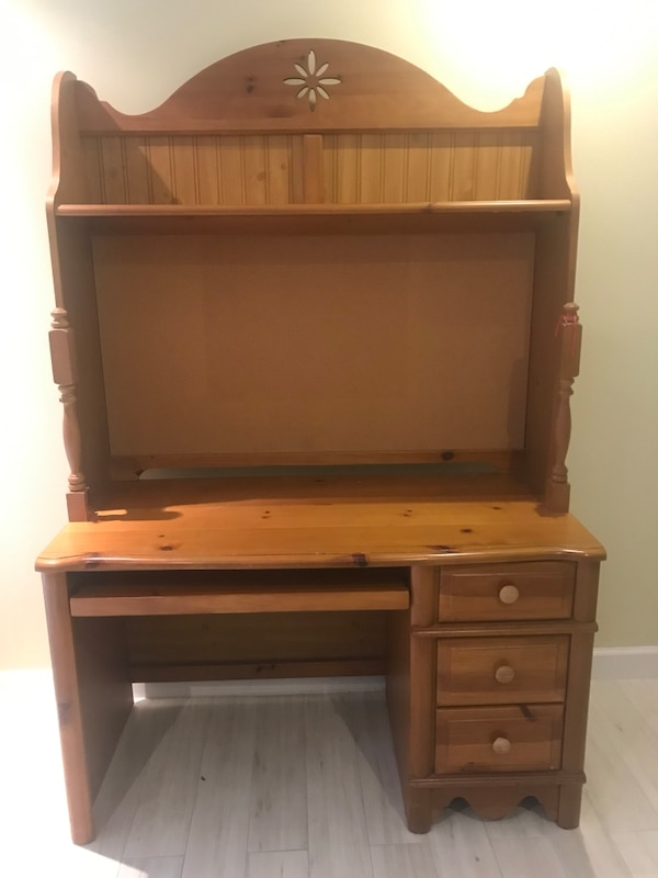 brown wooden single pedestal desk with hutch