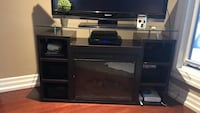 black flat screen TV with black wooden TV stand Toronto, M3H 4P3