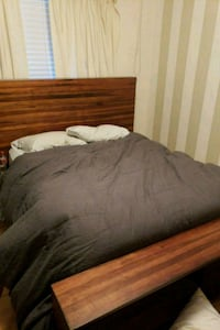 brown wooden bed frame with gray bed sheet San Jose, 95126
