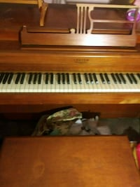 brown and white upright piano