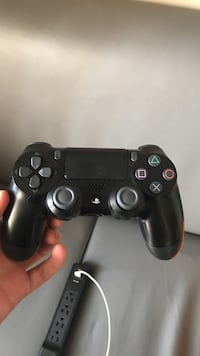 black Sony PS4 game controller 511 mi