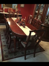 Queen Anne cherry table with leaf, 2 captain & 4 regular chairs