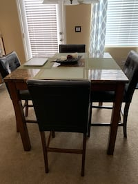 Table with 4 chairs.  Small tears in one chair Las Vegas, 89166
