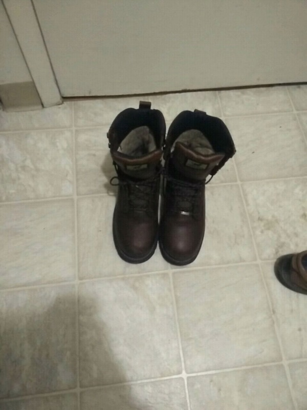 pair of black leather  boots.not steel boot