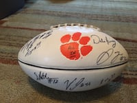 white and red signed football