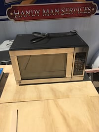 gray G.E microwave oven