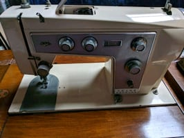 white and gray sewing machine