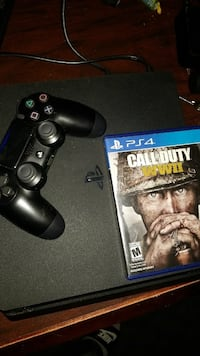 Sony PS4 console with controller and game.
