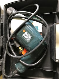 black and green Black&Decker corded power drill