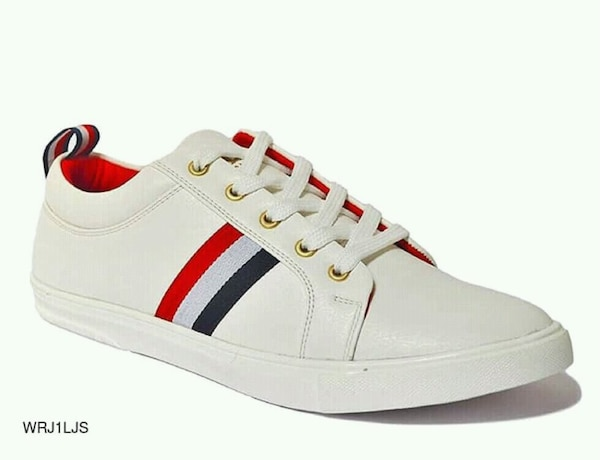 unpaired white and red Adidas low top sneaker