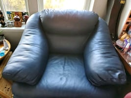 Blue leather chair and ottoman