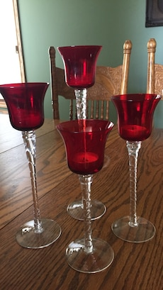 four red-and-clear glass long footed candle holders