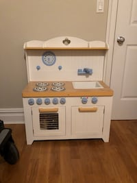 white and brown wooden kitchen cabinet New York, 10032