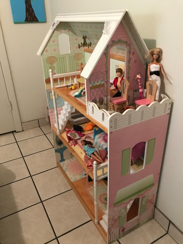 Used Pink White And Green Wooden Dollhouse For Sale In