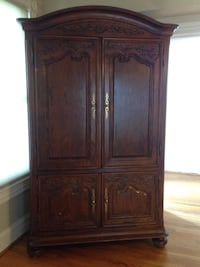 Large wardrobe/entertainment center, brown wood, with integrated outlets  Hyattsville, 20781