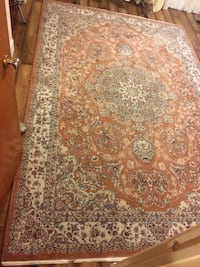 brown and white floral area rug Burnaby, V3N 3E9